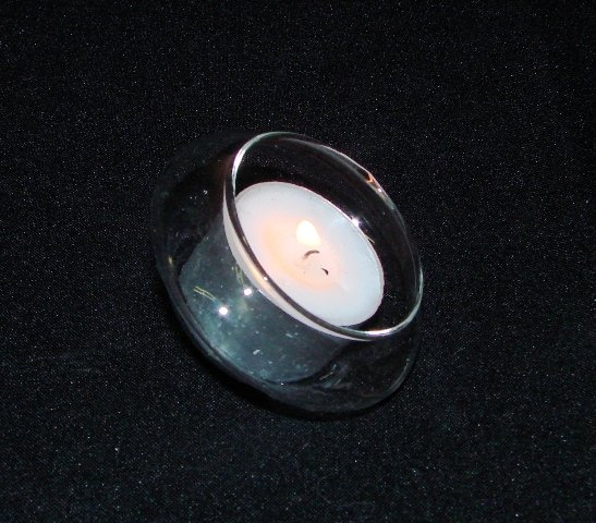 Tea light holder, floating